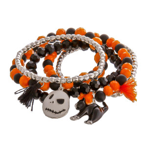 """Halloween """"Nightmare Before Christmas"""" charm beaded stretch bracelet set with tassel accents. Approximately 3"""" in diameter unstretched. Fits up to a 6"""" wrist."""