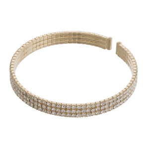 """Cubic zirconia tennis inspired cuff bracelet. Approximately 3"""" in diameter. Fits up to a 6"""" wrist."""