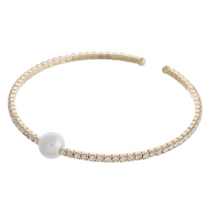 """Cubic zirconia pearl cuff bracelet. Approximately 3"""" in diameter. Fits up to a 6"""" wrist."""