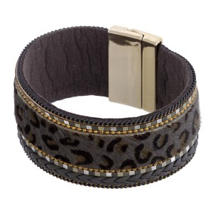 """Faux fur leopard print magnetic bracelet featuring braided details. Approximately 3"""" in diameter and 1"""" in width. Fits up to a 6"""" wrist."""