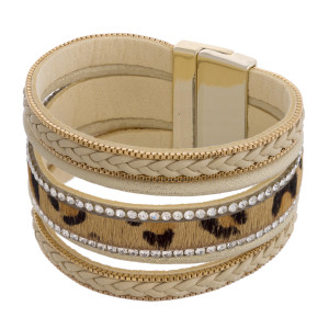 """Multi strand leopard print faux leather magnetic bracelet featuring rhinestone and braided accents. Approximately 3"""" in diameter and 1.25"""" in width. Fits up to a 6"""" wrist."""