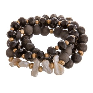 """Semi precious beaded stretch bracelet set of four with freshwater pearl details.   - Approximately 3"""" in diameter unstretched  - Fits up to a 6"""" wrist"""
