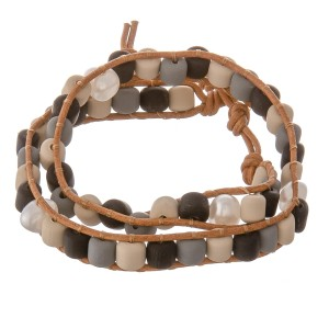 """Rubber beaded color block cord wrap bracelet with pearl accents.  - Pull through button clasp - Adjustable 2"""" extender - Approximately 3"""" in diameter - Fits up to an 7"""" wrist"""