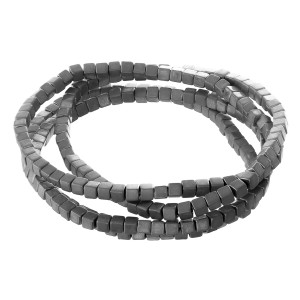 "Metal tone block beaded stretch bracelet set.  - 4pcs/pack - Approximately 3"" in diameter unstretched - Fits up to a 7"" wrist"