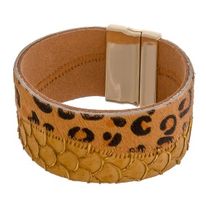 "Faux fur leopard print snakeskin magnetic bracelet. Approximately 3"" in diameter and 1.25"" in width. Fits up to a 6"" wrist."