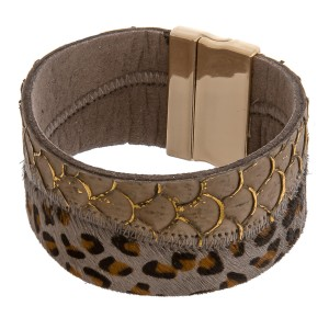 """Faux fur leopard print snakeskin magnetic bracelet. Approximately 3"""" in diameter and 1.25"""" in width. Fits up to a 6"""" wrist."""