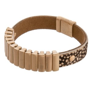 "Cowhide animal print bar magnetic bracelet.  - Magnetic closure - Approximately 3"" in diameter - Fits up to a 6"" wrist"