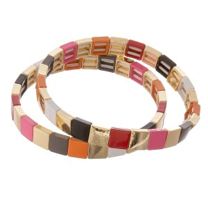 "Gold shiny enamel coated color block stretch bracelet set.  - 2pcs/pack - Approximately 3"" in diameter unstretched - Fits up to a 7"" wrist"