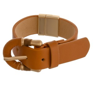"""Adjustable faux leather magnetic buckle bracelet.  - Adjustable band  - Magnetic closure - Approximately 3"""" in diameter"""