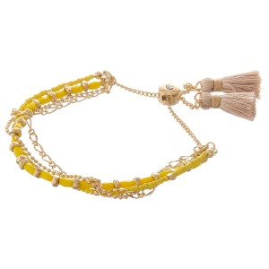"Dainty multi strand beaded chain bolo tassel bracelet.  - Ajustable bolo closure - Approximately 3"" in diameter - Fits up to an 8"" wrist"