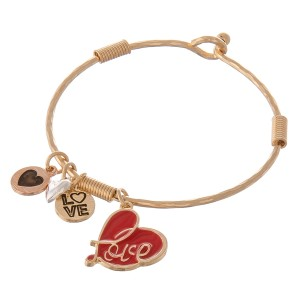 "Multi metal tone enamel coated heart charm bangle bracelet.  - Hook closure - Approximately 2.5"" in diameter - Fits up to a 5"" wrist"