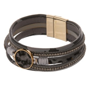 "Faux leather wrapped multi strand leopard print magnetic bracelet with cowhide focal, rhinestones and thread wrapped details.  - Magnetic closure - Approximately 3"" in diameter - Fits up to a 6"" wrist"