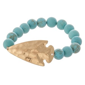 "Semi precious beaded hammered arrow stretch bracelet.  - Focal approximately 1.75""  - Approximately 3"" in diameter - Fits up to a 7"" wrist"