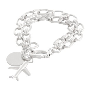 "Chain Link Layered Airplane Charm Bracelet in Worn Silver.  - Charm approximately 1"" - Approximately 3"" in diameter - Fits up to a 6"" wrist"