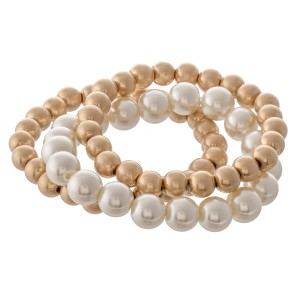 """Worn Pearl Beaded Stretch Bracelet Set.  - 3pcs/set - Bead Sizes- 7mm, 10mm - Approximately 3"""" in diameter - Fits up to a 7"""" wrist"""