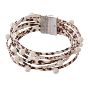 """Faux Leather Multi-Strand Animal Print Magnetic Bracelet Featuring Pearl Bead Details.  - Magnetic Closure - Approximately 3"""" in Diameter - Fits up to a 6"""" Wrist"""