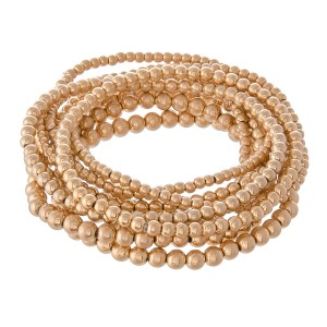 """Beaded Ball Stacking Stretch Bracelet Set in Worn Gold.  - 9pcs/set - 2mm, 3mm, 4mm Bead Sizes - Approximately 3"""" in diameter - Fits up to a 7"""" wrist"""
