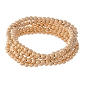 """Beaded Ball Stacking Bracelet Set in Worn Gold.  - 5pcs/set - 3.5mm Bead Size - Approximately 3"""" in diameter - Fits up to a 7"""" wrist"""