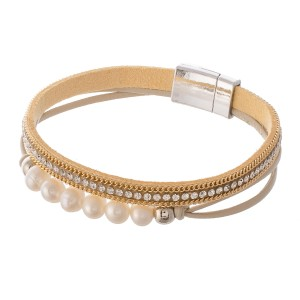 "Pearl beaded rhinestone cord magnetic bracelet.  - Magnetic closure - Approximately 3"" in diameter - Fits up to a 6"" wrist"