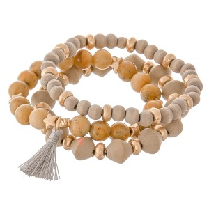 """Semi precious wood beaded star stretch bracelet set with tassel.  - 3pcs/set - Approximately 3"""" in diameter unstretched  - Fits up to a 7"""" wrist"""