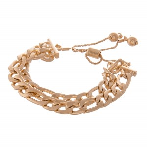 "Curb Chain Link Bolo Bracelet in Worn Gold.  - Approximately 3"" in diameter - Fits up to an 8"" wrist"