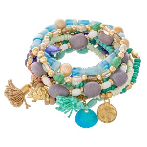 """Royal Mint Semi Precious Heishi Beaded Sea Turtle Charm Tassel Stacking Stretch Bracelet Set with Shell Detail.  - 10pcs/set - Approximately 3"""" in diameter - Fits up to a 7"""" wrist"""