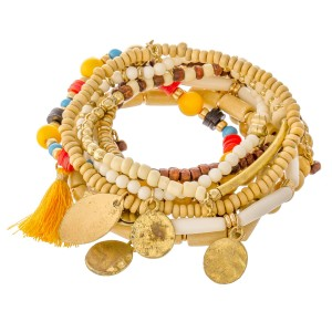 """Natural Multi Wooden Beaded Boho Coin Tassel Stretch Bracelet Set.  - 10pcs/set - Approximately 3"""" in diameter unstretched - Fits up to a 7"""" wrist"""