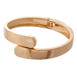 """Overlap Hinge Bangle in Worn Gold.  - Approximately 2.5"""" in diameter - Fits up to a 5"""" wrist"""