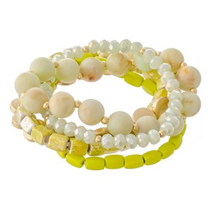 """Natural Stone Beaded Stretch Bracelet Set with Worn Detailing.  - 5pcs/set - Approximately 3"""" in diameter - Fits up to a 7"""" wrist"""