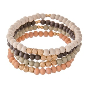 """Multi Wood Beaded Stretch Bracelet Set Featuring Gold Accents.  - 4pcs/set - Approximately 3"""" in diameter - Fits up to a 7"""" wrist"""