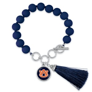 """Auburn Beaded Game Day Tassel Bracelet Featuring Adjustable Toggle Bar.  - Charm & Tassel (approx) 1"""" - Bead Size: 9mm - Approximately 3"""" in Diameter - Fits up to a 7"""" Wrist"""