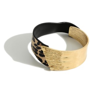 """Bracelet Featuring Gold and Faux Leather Accents.   - Approximately 3"""" in Diameter - Button Closure"""
