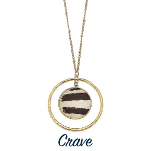 Long crave necklace with brown and cream patterns.