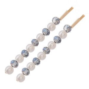 """Hair pin set featuring faceted and pearl beaded details. Two pins per pack. Approximately 2.5"""" in length."""