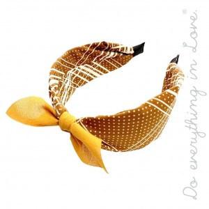 Do everything in Love brand micro dot print knotted bow headband.  - One size - 100% Polyester