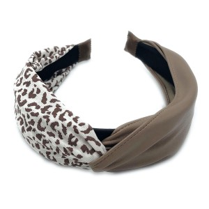 Do everything in Love Brand Half Animal Print Half PU Headband.  - One size fits most - 50% Polyester / 50% PU