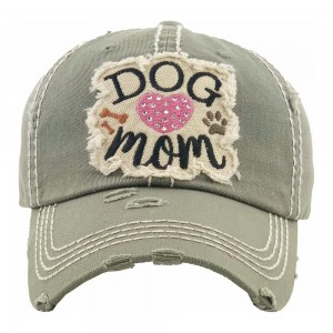 "Rhinestone 'Dog Mom"" embroidered vintage distressed baseball cap.  - One size fits most - Adjustable velcro closure - 100% Cotton"