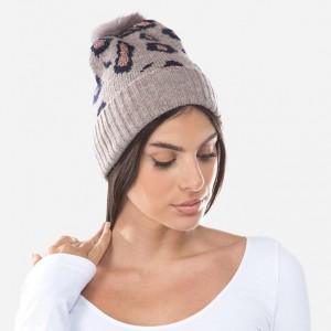 Leopard Print Knit Faux Fur Pom Beanie Featuring Metallic Accents.  - One size fits most  - 63% Polyester / 33% Acrylic / 4% Spandex