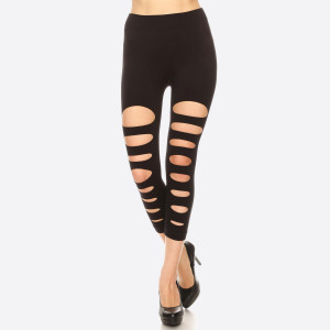 Show a little skin with the trendy, intentionally Distressed look of these Elastic Black Ripped Capri Leggings. You can now give your outfits a bit of edge and a lot of texture with these Capri length leggings that cling to the curves of your form in a flattering way without being uncomfortably tight. 