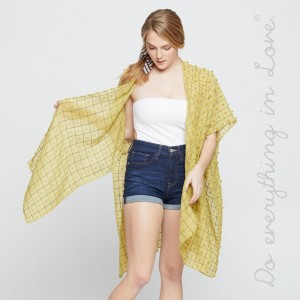 "Do everything in Love brand lightweight bobble kimono.  - One size fits most 0-14 - Approximately 37"" L - 100% Polyester"