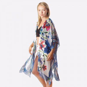 """Women's lightweight floral kimono.  - One size fits most 0-14 - Approximately 37"""" L - 100% Polyester"""