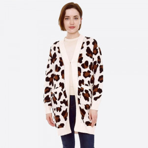 """Leopard print knit cardigan with front pocket details.  - One size fits most 0-14 - Approximately 32"""" in length - 22% Polamide, 28% Polyester, 50% Viscose"""