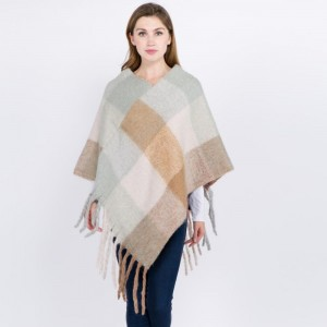 """Soft Fuzzy Knit Color Block Poncho Featuring Oversized Fringe Tassels.  - One size fits most 0-14 - Approximately 37"""" L - 100% Acrylic"""