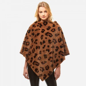 """Women's Faux Fur Leopard Print Poncho.  - One size fits most 0-14 - Approximately 32"""" L - 100% Polyester"""