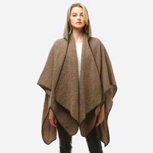 """Soft touch hooded boucle ruana/wrap with whip stitch trim.   - One size fits most 0-14 - Approximately 33"""" in length - 100% Polyester"""