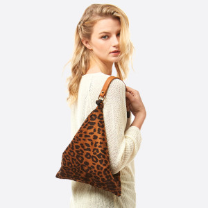 """Leopard print top handle tote bag featuring:  - Square shape/triangle shape - Side button closure - Knotted handle detail - No pockets  - Approximately 13"""" W x 10"""" T - 100% Polyester"""