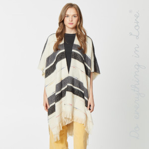 """Do everything in Love Brand Soft Knit Stripe Kimono Featuring Fringe Tassels.  - One size fits most 0-14 - Approximately 37"""" L - 50% Acrylic, 50% Polyester"""