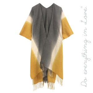 "Do everything in Love Brand Ombre Kimono Featuring Fringe Tassels.  - One size fits most 0-14 - Approximately 37"" L - 70% Polyester, 30% Viscose"