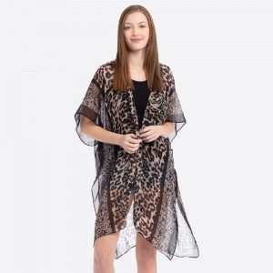 """Women's Lightweight Sheer Multi Leopard Print Kimono.  - One size fits most 0-14 - Approximately 37"""" L - 100% Polyester"""