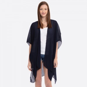 """Solid color pleated kimono.  - One size fits most 0-14 - Approximately 37"""" L - 100% Polyester"""